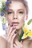 Beautiful girl with art make-up, flowers, and design nails manicure. beauty face. Stock Photo