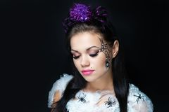 Beautiful girl art makeup with spiders royalty free stock photos