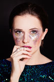 Beautiful Girl with Artistic Makeup. Face closeup royalty free stock image
