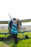 Beautiful girl as old plane propeller Stock Photography