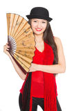 Beautiful girl asian in hat with a fan. Royalty Free Stock Photos