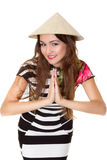 Beautiful girl in the Asian straw hat Stock Photo