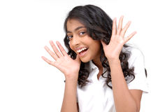 Beautiful girl with an astonish and happy expression Stock Image