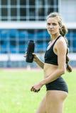 Beautiful girl athlete drinking water Royalty Free Stock Photos