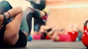 Girl athlete engaged in exercises on work abdominal. Royalty Free Stock Photos