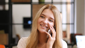 Beautiful Girl Attending Phone Call, Talking with Friend Royalty Free Stock Photography