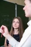 Beautiful girl attentively looks at partners Royalty Free Stock Image