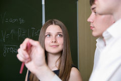 Beautiful girl attentively looks at partners Royalty Free Stock Images