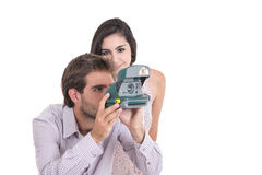 Beautiful girl and attractive man using an instant Royalty Free Stock Image