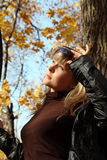 Beautiful girl on autumn background Royalty Free Stock Images