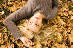 Beautiful girl in the Autumn fall. Beautiful girl under the Autumn trees Royalty Free Stock Images