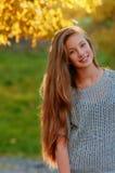 Beautiful girl in the Autumn fall Stock Photos