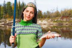 Beautiful girl at the autumn fishing. In Siberia Royalty Free Stock Photos