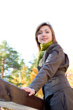 Beautiful girl in autumn forest stock photography