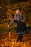 Beautiful girl in autumn forest. Beautiful girl with umbrella in autumn forest Stock Photography