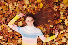 Beautiful girl at autumn. Healthy Long Hair Stock Photos