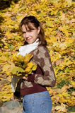 The beautiful girl with autumn leaves Royalty Free Stock Images
