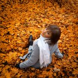 A beautiful girl on the autumn leaves Royalty Free Stock Image