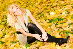 Beautiful girl in autumn park Royalty Free Stock Photos