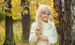 The beautiful girl in autumn park Royalty Free Stock Image