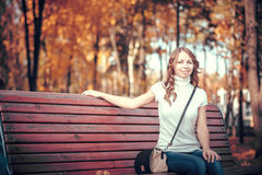 Beautiful girl in the autumn park Stock Images