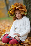 Beautiful girl in autumn park with wreath of Stock Image