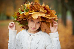 Beautiful girl in autumn park with wreath of Stock Photography