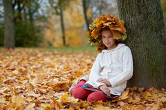 Beautiful girl in autumn park with wreath of Royalty Free Stock Images