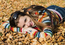 The beautiful girl on autumn walk Stock Photography