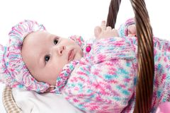 Beautiful girl baby in a basket on a white background Royalty Free Stock Image