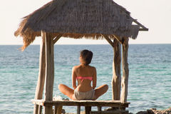 Beautiful girl back in relax on the beach at sunset. Indonesia Stock Photography