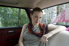 Beautiful girl on back sitting of the car Royalty Free Stock Photos