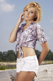 Beautiful girl on background blue sky Stock Photography