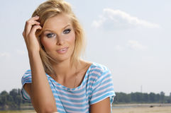 Beautiful girl on background blue sky Stock Photos