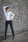 Beautiful girl on a background of gray brick wall Stock Photo