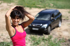 Beautiful girl on the background of his car Royalty Free Stock Image