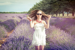 Beautiful girl on the background of lavender fields Stock Photo
