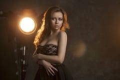 Beautiful girl on the background light stock photos