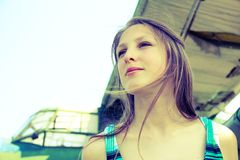 Beautiful girl on a background of old planes Royalty Free Stock Photo