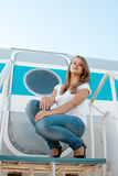 Beautiful girl on the background plane Royalty Free Stock Images
