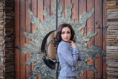 Beautiful girl on a background of wooden gates Royalty Free Stock Photography