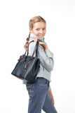 Beautiful girl with a bag. Girl in a coat with a bag Royalty Free Stock Images