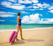 Beautiful girl with a bag in a beach Royalty Free Stock Image