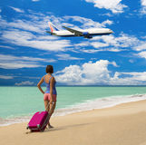 Beautiful girl with a bag in a beach Stock Photography