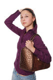 The beautiful girl with a bag on shoulders, Stock Images