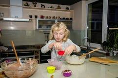 Beautiful girl baking Stock Photo