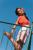 Beautiful girl at balcony with fashion dress and hair flower Stock Photo