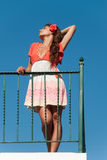 Beautiful girl at balcony with fashion dress and hair flower Stock Images