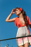Beautiful girl at balcony with fashion dress and hair flower Royalty Free Stock Photos