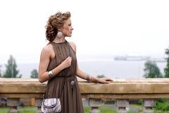 Beautiful girl on the balcony Royalty Free Stock Photography
